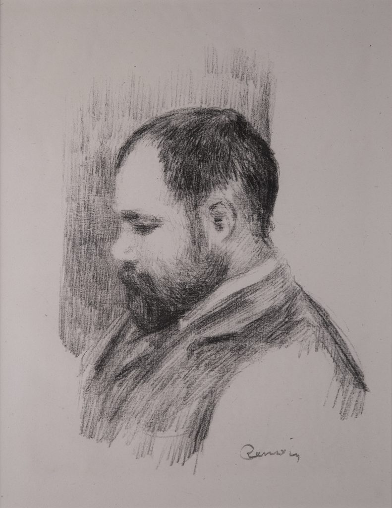 A full profile of a bearded man glancing downward.