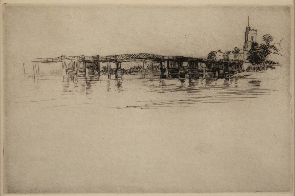 A landscape scene showing a bridge above water. There are buildings in the distance.